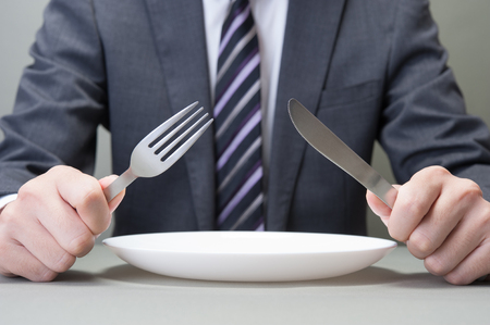 Men have a knife and fork Stock Photo