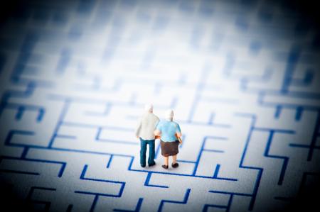 forgetfulness: Couple of elderly walk through the maze