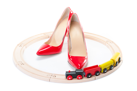 public servants: Red high heels and a toy locomotive