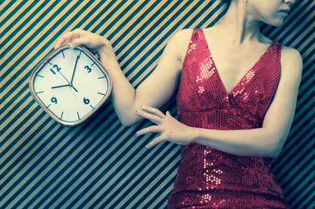 curfew: woman have clock Stock Photo
