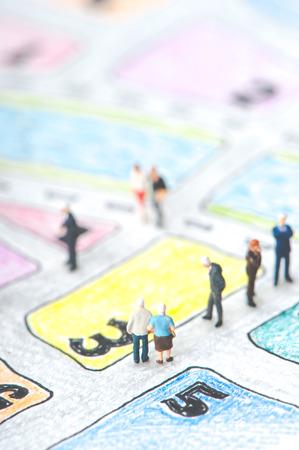 elderly couple: Elderly couple walking on the handwritten map Stock Photo
