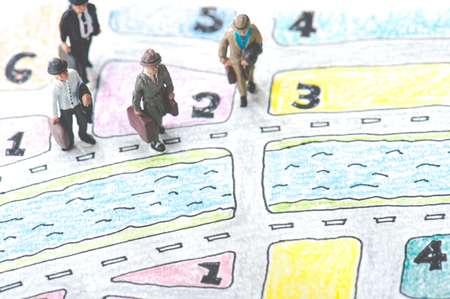 lost in space: Handwritten map and a miniature businessmen Stock Photo