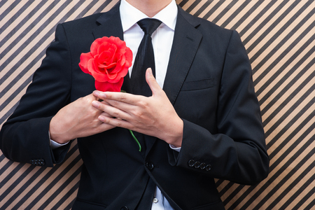 Businessman have a red rose
