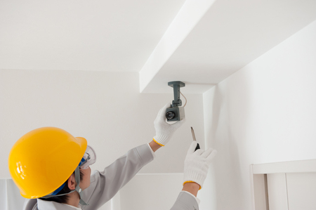 theft prevention: Workers installing a security camera