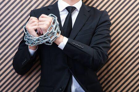 restraint: Businessman with chain