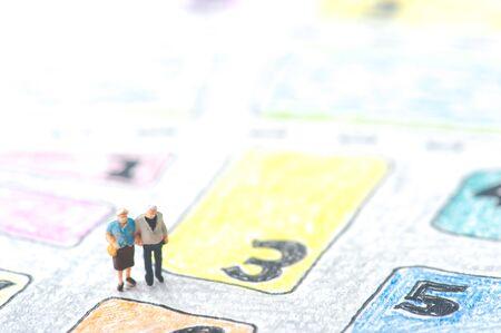 lost in space: Elderly couple walking on the handwritten map Stock Photo