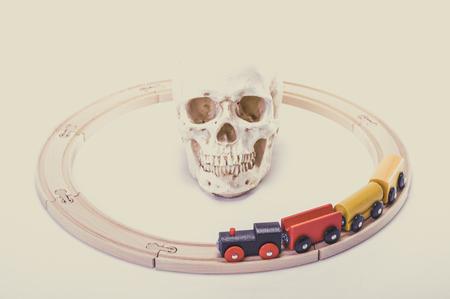living skull: Skull and toy locomotive