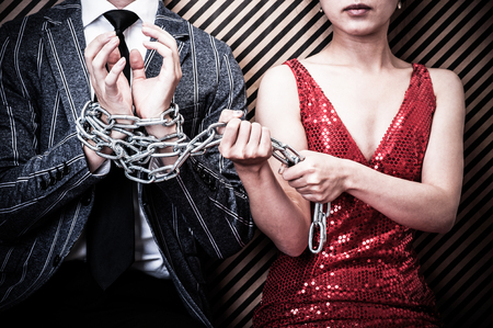 bound woman: Woman bound men with chain