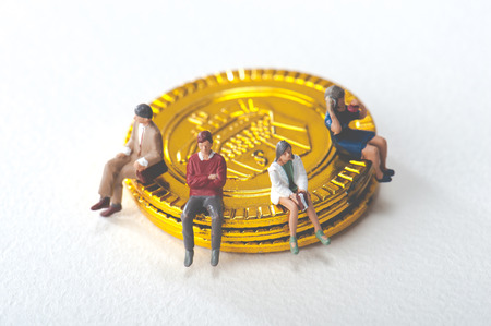 People are sitting on gold coin