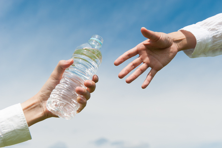 bottled: Bottled water, help each other Stock Photo