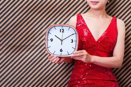 adultery: woman have clock Stock Photo