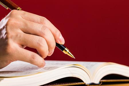 school exam: White book Red background Stock Photo