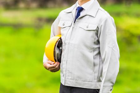 Men dressed in work clothes, natural background Stock Photo