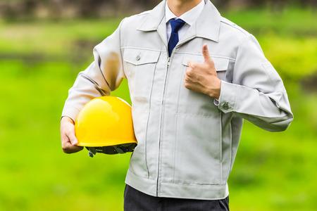 Men dressed in work clothes, natural background Zdjęcie Seryjne