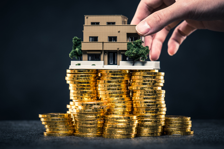 housing lot: A large amount of money and house model Stock Photo