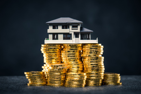 dream land: A large amount of money and house model Stock Photo