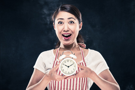 Surprised face housewife and time management Stock Photo