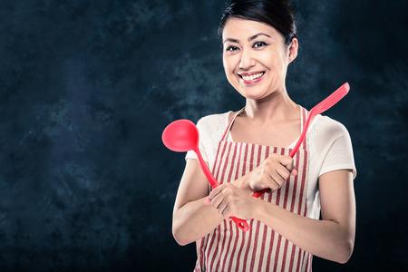 Asian woman wearing an apron