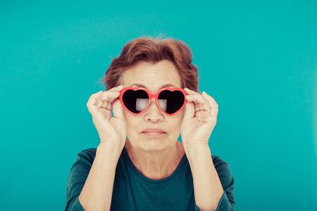 flashy: elderly woman blue background