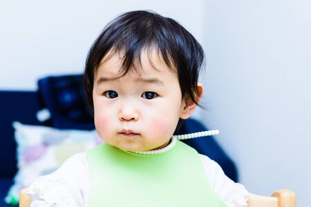 Cute baby with a meal