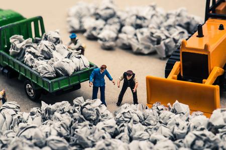 Garbage and miniature dolls Archivio Fotografico