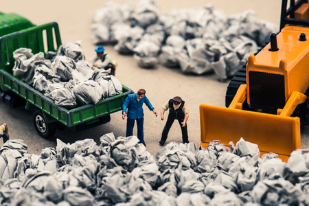 Garbage and miniature dolls Stock Photo