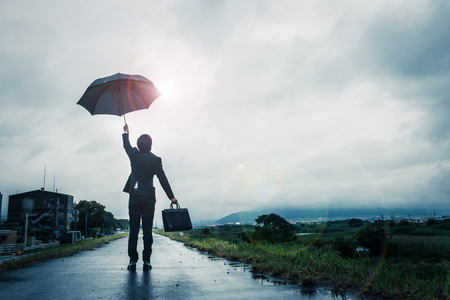 Businessman holding an umbrella, the sky after the rain Stok Fotoğraf