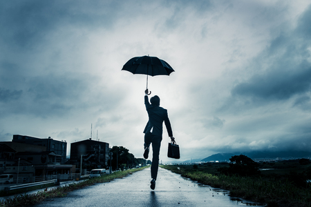 systemic: businessman are holding an umbrella Stock Photo