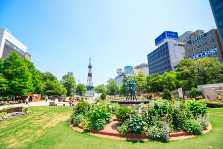 Sapporo, Japan -  June 30, 2017 - Television tower at Odori Park, Sapporo, Hokkaido, Japan.Odori Park is a park located in the heart of Sapporo.The Sapporo TV Tower built in 1957. Sajtókép