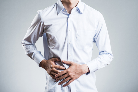 Male, abdominal pain Standard-Bild