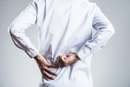 Male, low back pain Foto de archivo