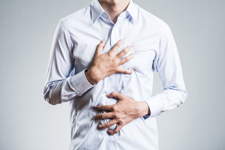 Male holding chest, sick