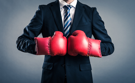 businessman with a boxing glove