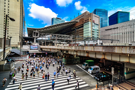 Osaka,Japan - July 12:Osaka Station is a major railway station in Osakas Umeda district that is served by a large number of local and interregional trains, but not the shinkansen which stop at Shin-Osaka Station. Редакционное