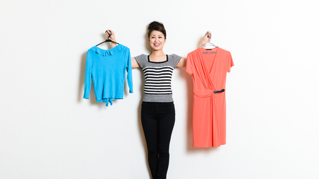 hangers: Asian women hold clothes
