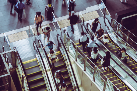 People riding escalators Stock fotó