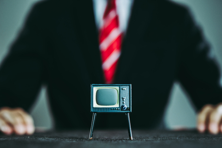 Television and businessman 写真素材