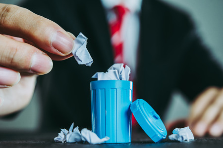 Businessman and trash Stock Photo