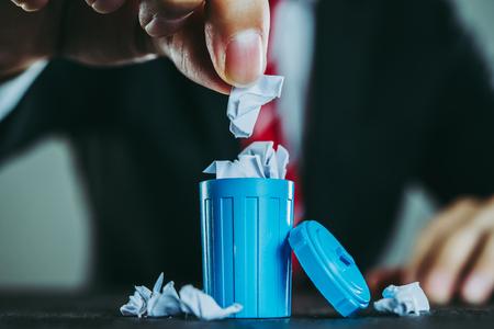 Businessman and trash 写真素材