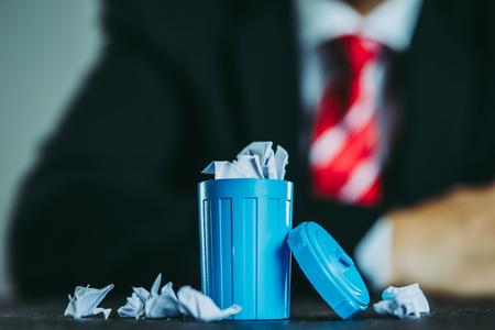 Businessman and trash Stock Photo