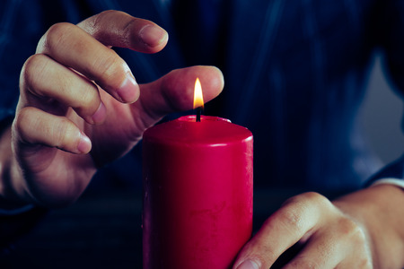red candle and a man Stock Photo