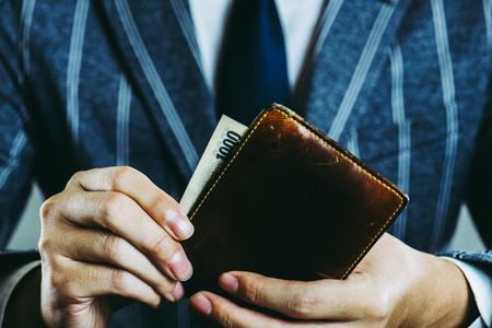 Businessman holding a wallet