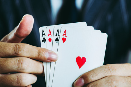 Businessman holding a Playing card