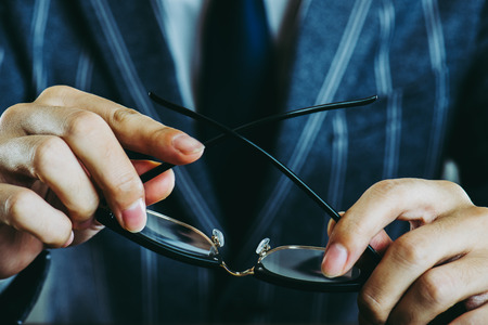 businessman holding glasses Stock Photo