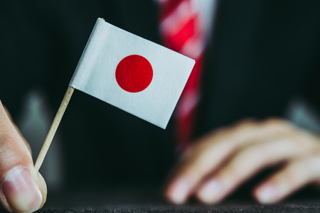 Businessman and national flag Stock Photo
