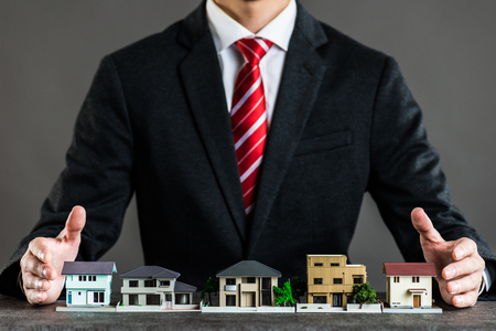 Businessman selling houses 写真素材
