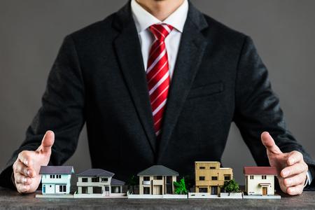 Businessman selling houses Standard-Bild