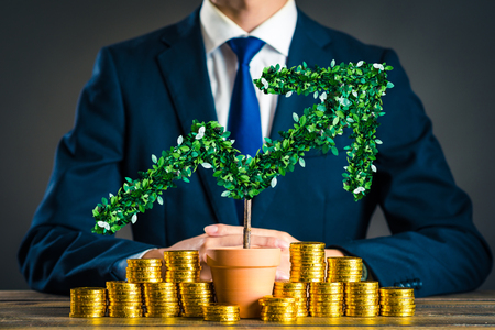 Businessmen with plants Stock Photo
