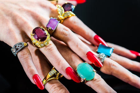 Womens hand with lots of  jewelry rings