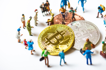 Miniature people with bit coin